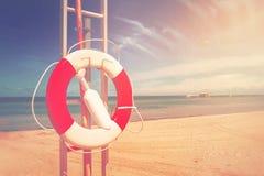 Lifebuoy, Life Preserver on Sandy Beach Stock Photos