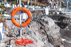 Lifebuoy life ring on the stone beach Italy stock photos