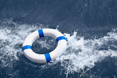 Lifebuoy, lifebelt, lifesaver in sea storm as help in danger Royalty Free Stock Image