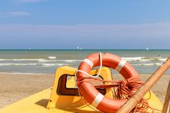 Lifebuoy on a lifeboat by the sea, Italy, Riccione royalty free stock photos