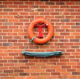 Lifebuoy. Hanging on a red brick wall Royalty Free Stock Image