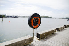 Lifebuoy is for lifesaver. They are alongside walkway near harbour Stock Photo