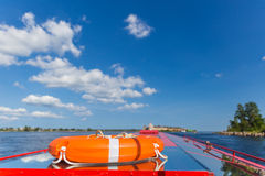 Lifebuoy. Lying on the roof of the boat which floats in the old Russian fortress Oreshek Royalty Free Stock Images