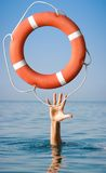 Lifebuoy for man in danger. Rescue situation Royalty Free Stock Photo