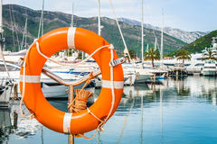 Lifebuoy. In the marina with expensive yachts, Tivat Stock Images