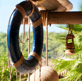 Lifebuoy, marine decor, wooden canopy for recreation Royalty Free Stock Photo