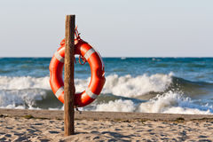 Lifebuoy in the Mediterranean. Lifebuoy on the sandy beach of the Mediterranean Stock Photo