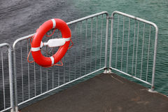 Lifebuoy on the metal railing Royalty Free Stock Image