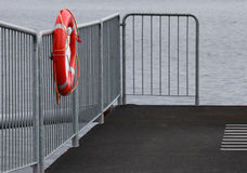 Lifebuoy on the metal railing Stock Images
