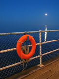 Lifebuoy and moon Royalty Free Stock Images