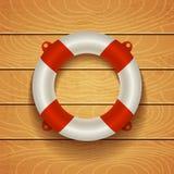 Lifebuoy na drewnianym tle Zdjęcie Stock