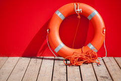 Lifebuoy nearby red wall of lifeguard station Royalty Free Stock Images