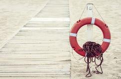 Lifebuoy next to boardwalk on the beach of Catania, Sicily, Italy royalty free stock photography