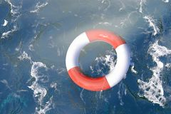 Lifebuoy in ocean. Lifebuoy floating in rough ocean seen from overhead royalty free stock photos