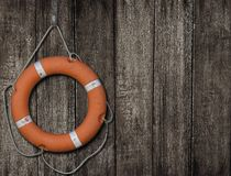 Lifebuoy on old wood background Stock Images
