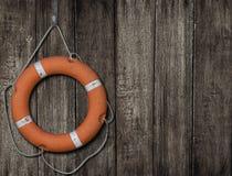 Lifebuoy on old wood background. Lifebuoy on dark wood background Stock Images