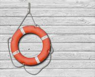 Lifebuoy on old wood white background Royalty Free Stock Images