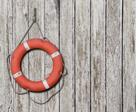 Lifebuoy on old wood white background Stock Photos