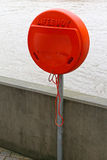 Lifebuoy. Orange Box With Lifebuoy at River Thames Stock Image