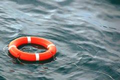 Lifebuoy orange floats on water Royalty Free Stock Image