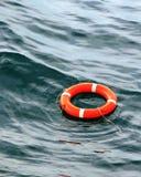 Lifebuoy orange floats on water Stock Images