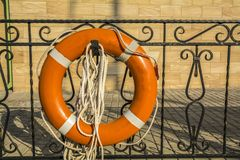 Lifebuoy orange hanging on the dock. Stock Images