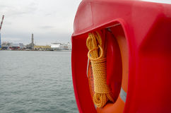 Lifebuoy and orange rope Stock Image