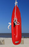 Lifebuoy på stranden Fotografering för Bildbyråer
