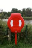 Lifebuoy at the park. Life belt container near open water at Rushcliffe Country Park, Nottinghamshire Royalty Free Stock Photos