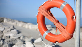 Lifebuoy for people near rocks at the sea Royalty Free Stock Images