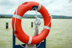 Lifebuoy on the pier Stock Photos