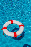 Lifebuoy in a pool Royalty Free Stock Photo