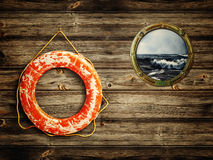 Lifebuoy and porthole. With sea view royalty free stock images