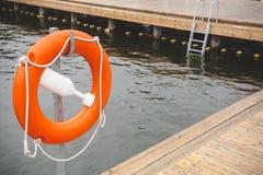 Lifebuoy przy plenerowym basenem Zdjęcie Stock