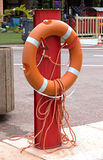 Lifebuoy. On a rack in the port royalty free stock image