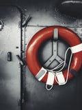 Lifebuoy. Red lifebuoy hanging in ship Royalty Free Stock Photo