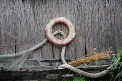 Lifebuoy. On reed wall and rope decorative Stock Images