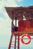 Lifebuoy on a rescue tower next to the sea Royalty Free Stock Images