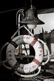 Lifebuoy and retro nautical lantern Royalty Free Stock Images