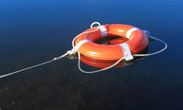 Lifebuoy Ring. A lifebuoy ring floating on water with a rope attached, concept for safety, security, or insurance, risk management, freedom, liberal Royalty Free Stock Photos