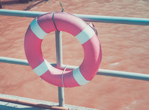 Lifebuoy ring hanging on the dock. Water safety equipment Stock Photo