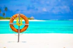 Free Lifebuoy Ring On Tropical White Beach Royalty Free Stock Photo - 53158955