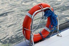 Lifebuoy ring. Red lifebuoy ring on board boats closeup Royalty Free Stock Images
