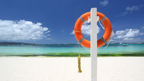 Lifebuoy ring on tropical beach. Lifebuoy ring on tropical sandy beach stock footage