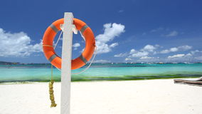 Lifebuoy ring on tropical beach stock video footage