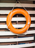 Lifebuoy ring on wooden railing Stock Photos