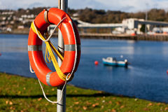 A lifebuoy. With a river and a boat in the background Royalty Free Stock Photos