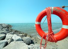 Lifebuoy with rope to rescue swimmers Stock Photos