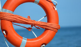 Lifebuoy with rope to rescue swimmers Stock Image