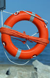 Lifebuoy with rope to rescue swimmers Royalty Free Stock Photo
